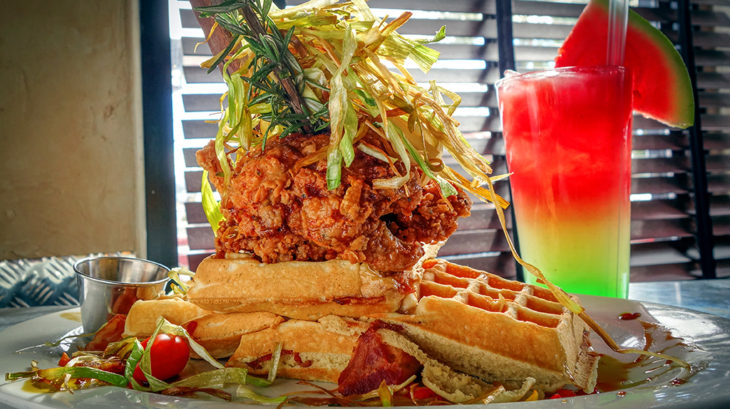 Chicken and Waffles with a colorful drink